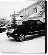 4x4 Pickup Trucks Parked In Driveway In Snow Covered Residential Street During Winter Saskatoon Sask Canvas Print by Joe Fox
