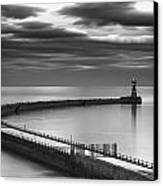 A Curving Pier With A Lighthouse At The Canvas Print by John Short