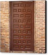 A Door In Toledo Canvas Print by Roberto Alamino
