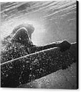 A Woman On A Surfboard Under The Water Canvas Print by Ben Welsh