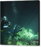 A Young Married Couple Scuba Diving Canvas Print by Michael Wood