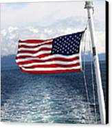 American Flag Blowing In The Wind At Sea Canvas Print by Jessica Foster