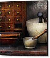 Apothecary - Pestle And Drawers Canvas Print by Mike Savad