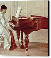 At The Piano Canvas Print by Theodore Robinson