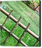 Bamboo Fence Canvas Print by Brett Price