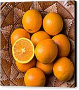 Basket Full Of Oranges Canvas Print by Garry Gay