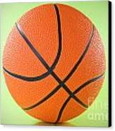 Basketball Ball Over A Green Background Canvas Print by G J