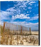 Beach Under Blue Skies Canvas Print by Debra and Dave Vanderlaan