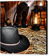 Black Cowboy Hat In An Old Barn Canvas Print by Olivier Le Queinec