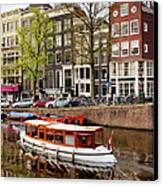 Boats On Canal In Amsterdam Canvas Print by Artur Bogacki