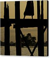 Buddhist Monk Walking Over U Bein's Bridge At Sunset Canvas Print by Ruben Vicente