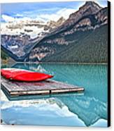 Canoes Of Lake Louise Alberta Canada Canvas Print by George Oze
