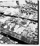 chocolates on display inside the la boqueria market in Barcelona Catalonia Spain Canvas Print by Joe Fox