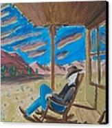 Cowboy Sitting In Chair At Sundown Canvas Print by John Lyes