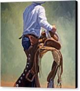 Cowboy With Saddle Canvas Print by Randy Follis