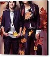 Fashionably Dressed Boy And Teenage Girl Fall Fashion Canvas Print by Oleksiy Maksymenko
