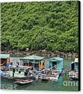 Fisherman Floatting Houses Canvas Print by Sami Sarkis