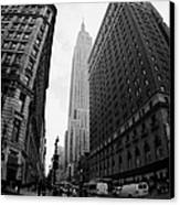 fisheye shot View of the empire state building from West 34th Street and Broadway new york usa Canvas Print by Joe Fox