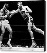 Floyd Patterson Throwing Hard Punch Canvas Print by Retro Images Archive