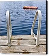 Footprints On Dock At Summer Lake Canvas Print by Elena Elisseeva