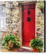 Geraniums By Red Door Canvas Print by Susan Savad