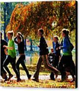 Girls Jogging On An Autumn Day Canvas Print by Susan Savad