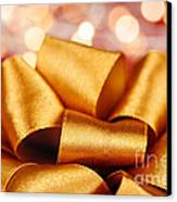 Gold Gift Bow With Festive Lights Canvas Print by Elena Elisseeva