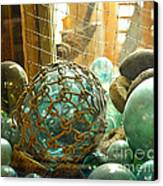 Green Glass Japanese Glass Floats Canvas Print by Artist and Photographer Laura Wrede
