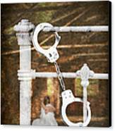 Handcuffs On Bed Canvas Print by Amanda Elwell