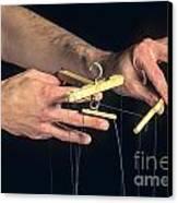 Hands Of A Puppeteer Canvas Print by Bernard Jaubert