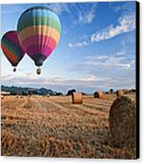Hot Air Balloons Over Hay Bales Sunset Landscape Canvas Print by Matthew Gibson