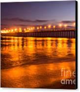 Huntington Beach Pier At Night Canvas Print by Paul Velgos