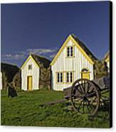 Icelandic Turf Houses Canvas Print by Claudio Bacinello