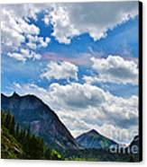 Iridescent Clouds Above Ouray Colorado Canvas Print by Janice Rae Pariza