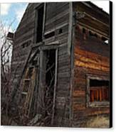 Ladder Against A Barn Wall Canvas Print by Jeff Swan