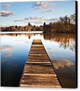 Landscape Of Fishing Jetty On Calm Lake At Sunset With Reflectio Canvas Print by Matthew Gibson