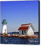 Lighthouse On The St Lawrence River Canvas Print by Olivier Le Queinec