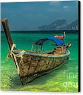 Longboat Canvas Print by Adrian Evans