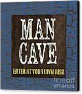 Man Cave Enter At Your Own Risk Canvas Print by Debbie DeWitt