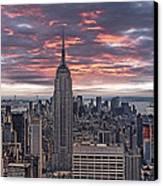 Manhattan Under A Red Sky Canvas Print by Joachim G Pinkawa