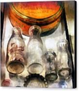 Milk Bottles In Dairy Case Canvas Print by Susan Savad