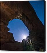 Moon Through Arches Windows Canvas Print by Michael J Bauer