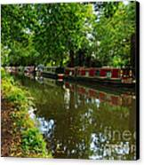 Narrowboats Moored On The Wey Navigation In Surrey Canvas Print by Louise Heusinkveld