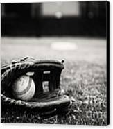 Old Baseball And Glove On Field Canvas Print by Danny Hooks