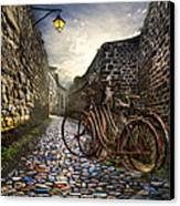 Old Bicycles On A Sunday Morning Canvas Print by Debra and Dave Vanderlaan