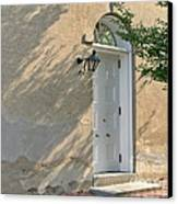 Old Door And Stucco Wall Canvas Print by Olivier Le Queinec