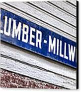Old Lumberyard Sign Canvas Print by Olivier Le Queinec