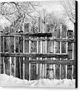 old patched up wooden fence using old bits of wood in snow Forget Saskatchewan Canada Canvas Print by Joe Fox