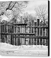 old patched up wooden fence using old bits of wood in snow Forget Saskatchewan  Canvas Print by Joe Fox