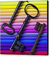 Old Skeleton Keys On Rows Of Colored Pencils Canvas Print by Garry Gay